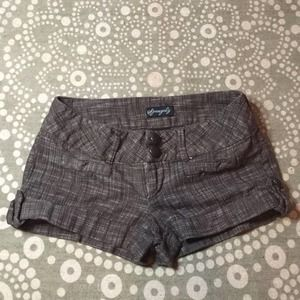 Cuffed thick waisted shorts with big buttons